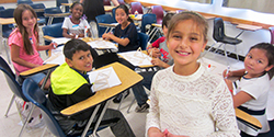 Photo of Cottage Elementary students smiling at Sacramento State