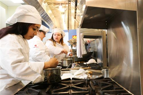 Culinary students at stove
