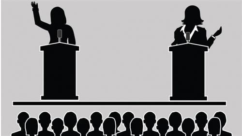 Two people have a debate as silhouettes