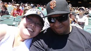 Mrs. and Mr. Day at a Giants game in Giants hats.