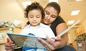 Mother reading with a child