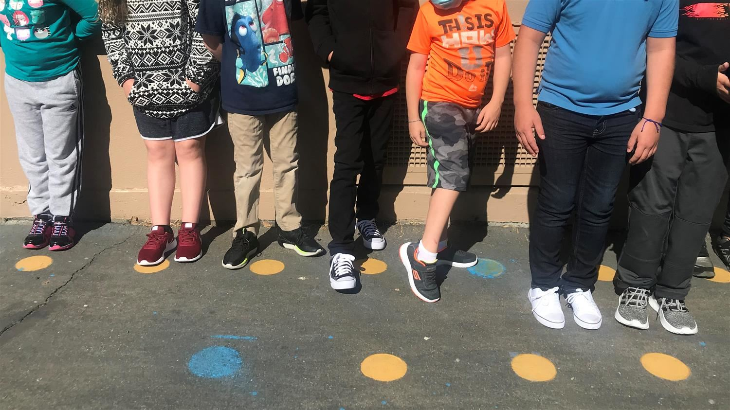 Soles for Young Souls, Inc. - students showing off their new shoes