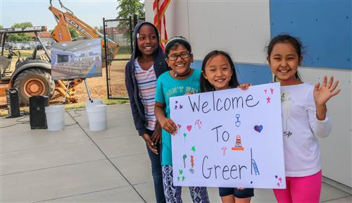 "Students with ""Welcome to Greer"" sign"
