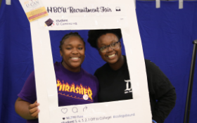 Smiling students surrounded by HBCU Recruitment Fair frame
