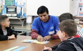 Intel volunteer reading to Skycrest students