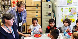 A community volunteer tours a classroom for Principal for a Day event