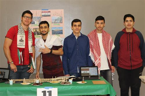 Group of Rio students at table during international fair
