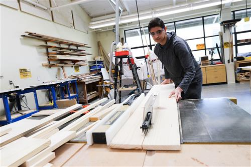 Student sawing board