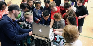 Tech Services working with students and SnowBot-3000
