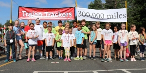 Trajan runners at 300,000 miles sign