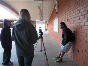 Media students film an interview