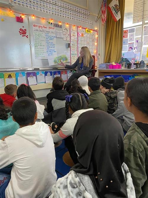 Community Member reading to class